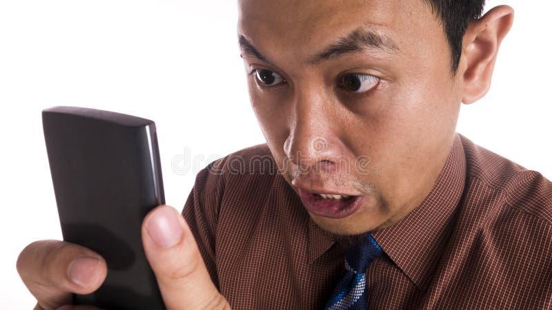恼怒的表示的滑稽的亚洲人关闭 免版税库存图片