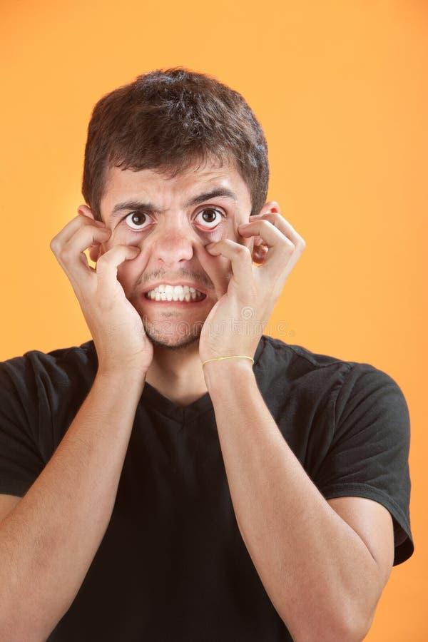 恼怒的青少年的年轻人 图库摄影