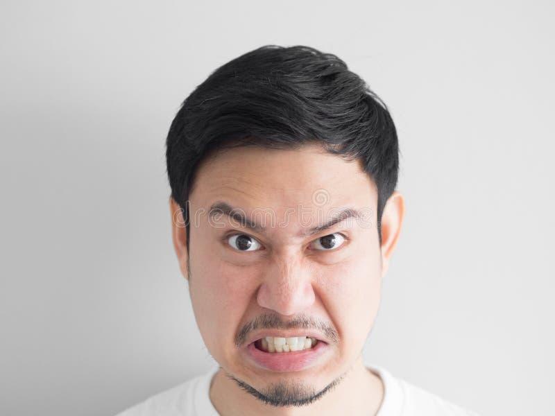 恼怒的面孔人顶头射击  库存照片
