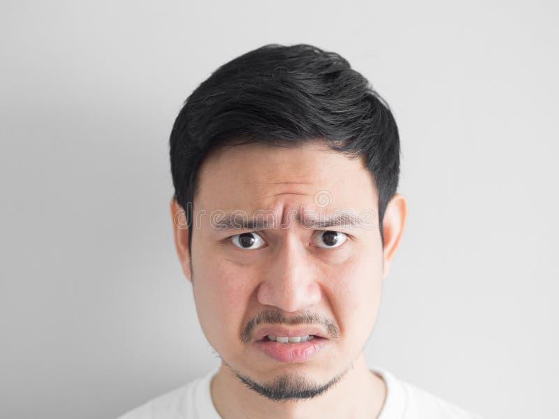 恼怒的面孔人顶头射击  免版税图库摄影
