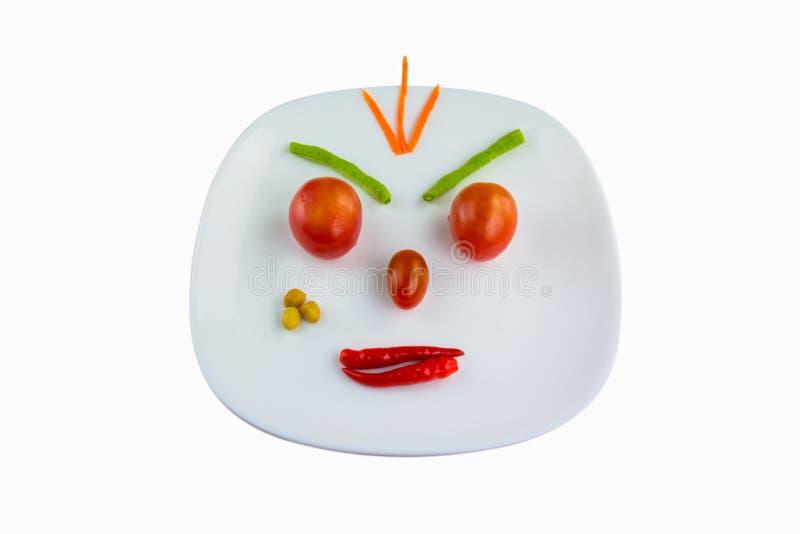 恼怒的面孔由菜做成 免版税图库摄影