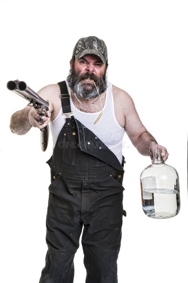 恼怒的饮用的农场工人 库存照片