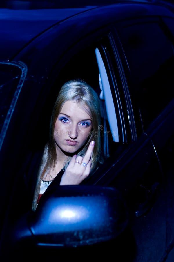 恼怒的驱动器女性打手势 库存图片