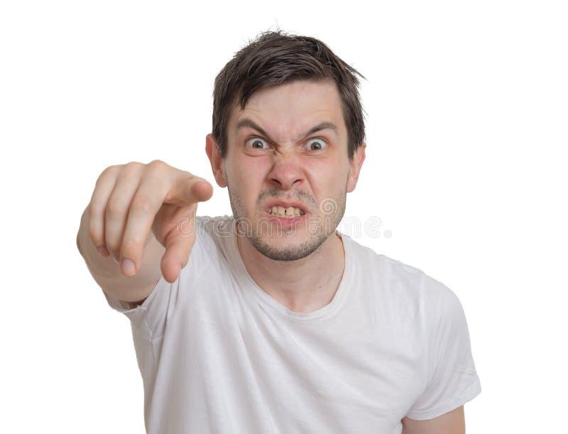 恼怒的年轻人指向往您 背景查出的白色 图库摄影