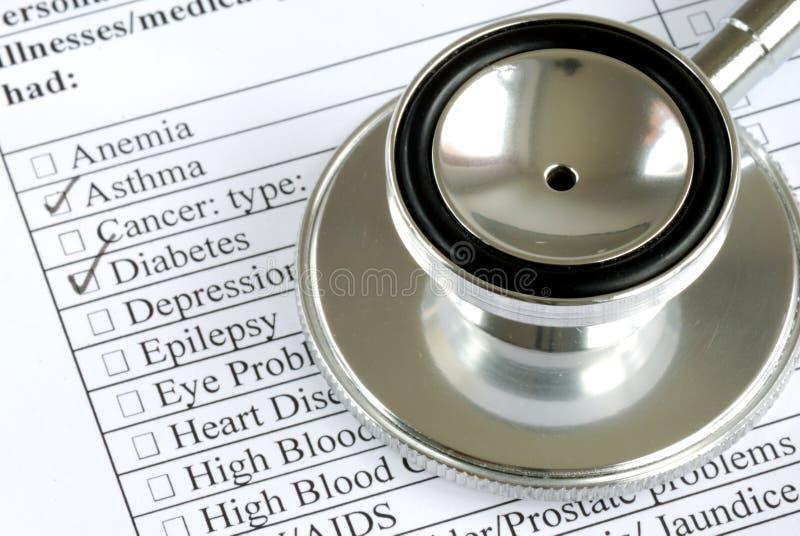 患者记录s听诊器 免版税库存图片