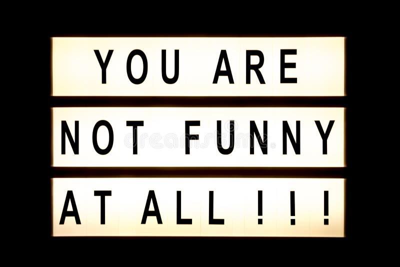 您不是滑稽的在所有垂悬的灯箱 库存图片