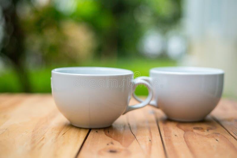 您的咖啡的加奶咖啡杯子 库存图片