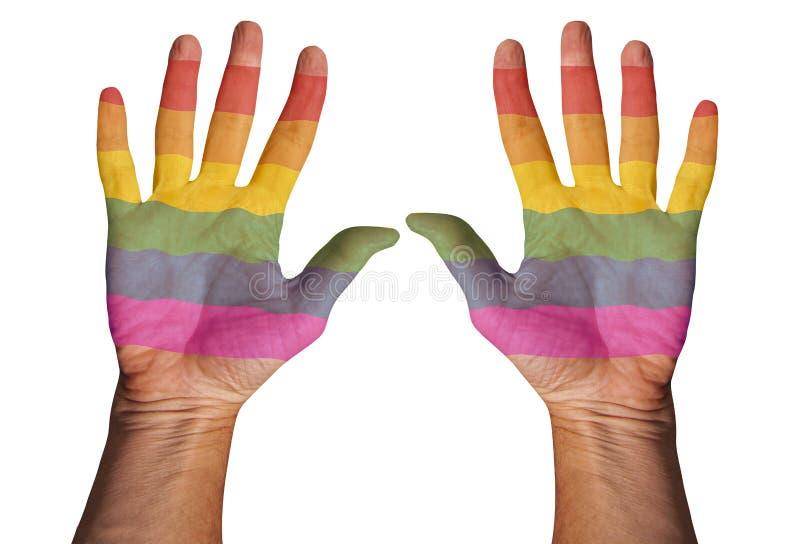 悬而未决两只的手绘在LGBTQ彩虹旗子颜色到达 r 免版税库存图片