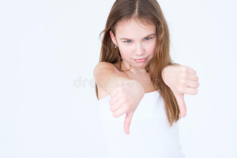 情感不许可的生气的儿童拇指下来 免版税库存照片