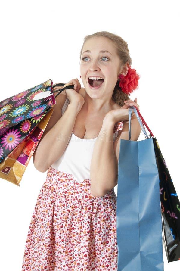 情感地拿着购物礼品的愉快的女孩请求。 库存照片