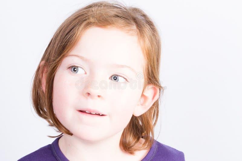情感美丽的小女孩 查出在灰色背景 免版税库存照片