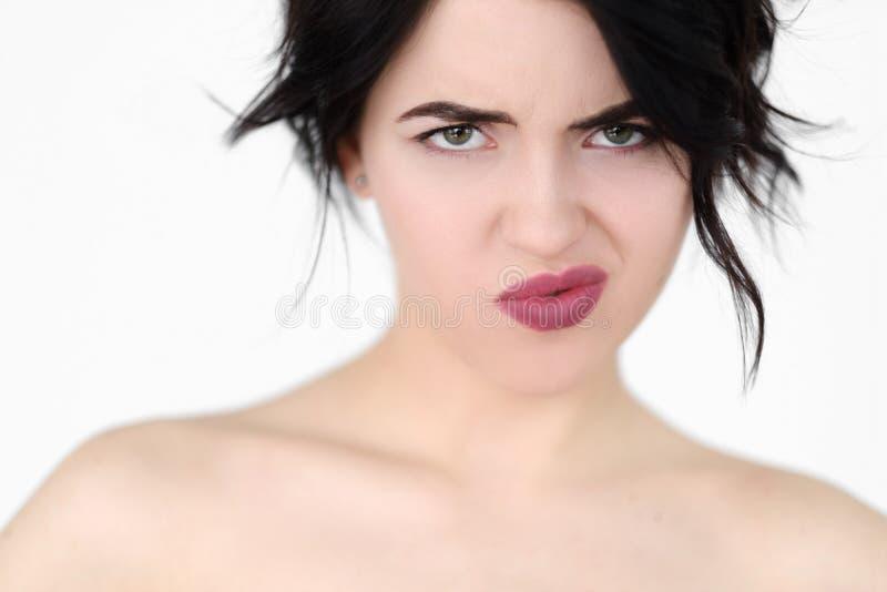 情感面孔不恭使生气的妇女困恼 图库摄影