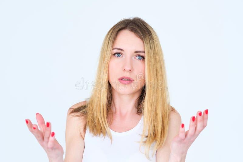 情感面孔困惑了为难的妇女手在损失 免版税图库摄影