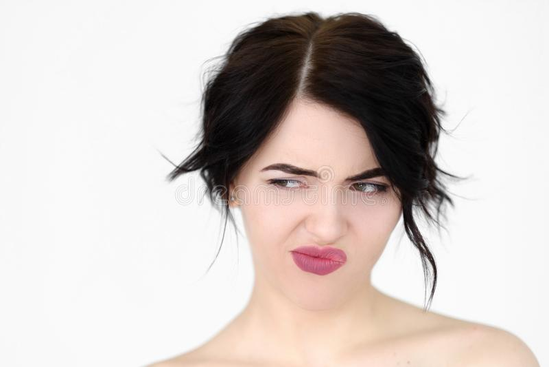 情感面孔牢骚羡慕妇女认为 图库摄影
