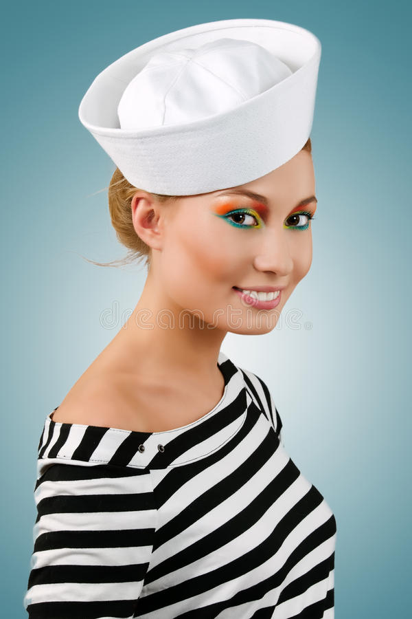 惊人的女孩水手微笑的年轻人 库存图片