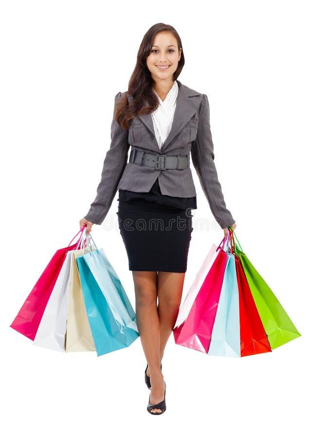 惊人的少妇运载的购物袋 库存照片