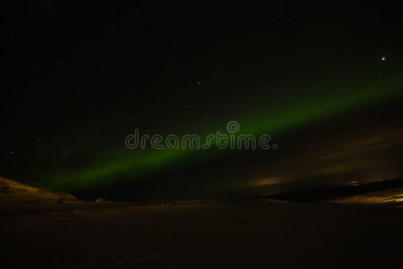 惊人的极光borealis活动或北极光在ekkero上 免版税库存照片
