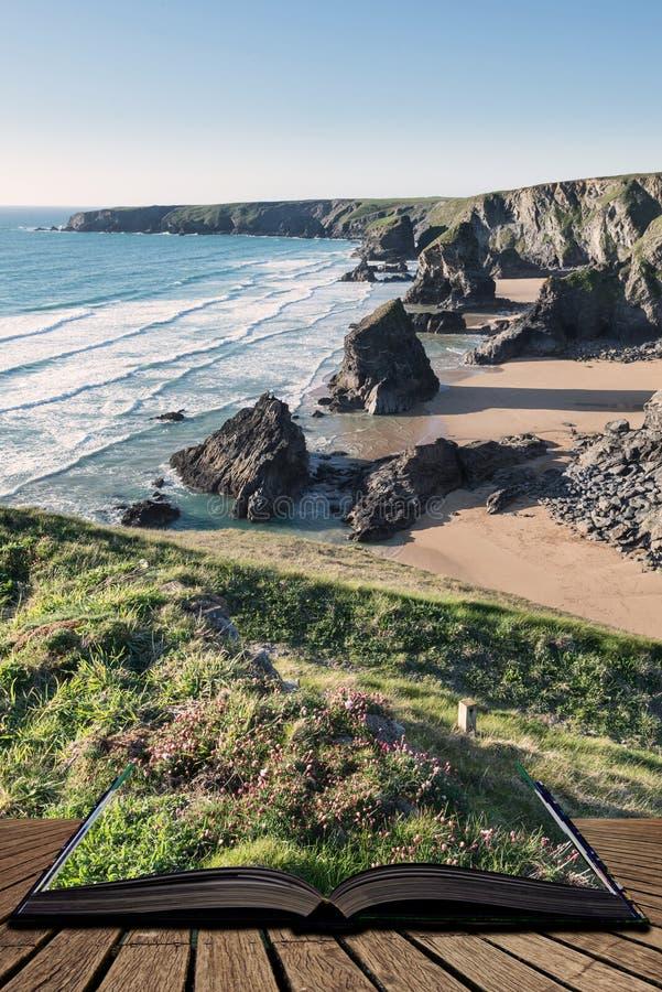 惊人黄昏日落Bedruthan步的风景图象在西部康沃尔郡海岸的在从开放故事书出来的页英国 免版税库存照片