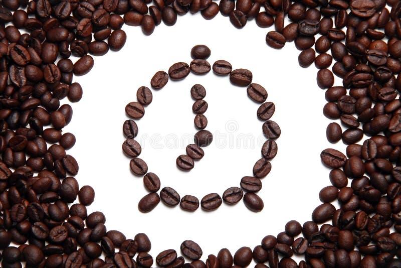 惊动豆做的时钟咖啡 免版税库存照片