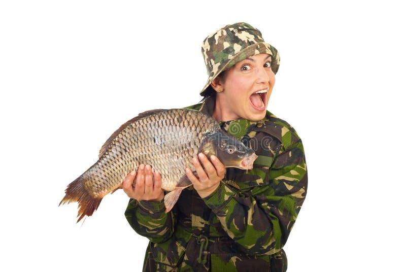 惊奇大鲤鱼渔夫藏品妇女 免版税库存图片