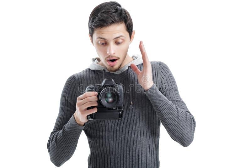 惊奇的专业摄影师用途DSLR数字照相机isol 图库摄影