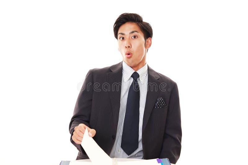 惊奇的亚洲生意人 免版税库存图片