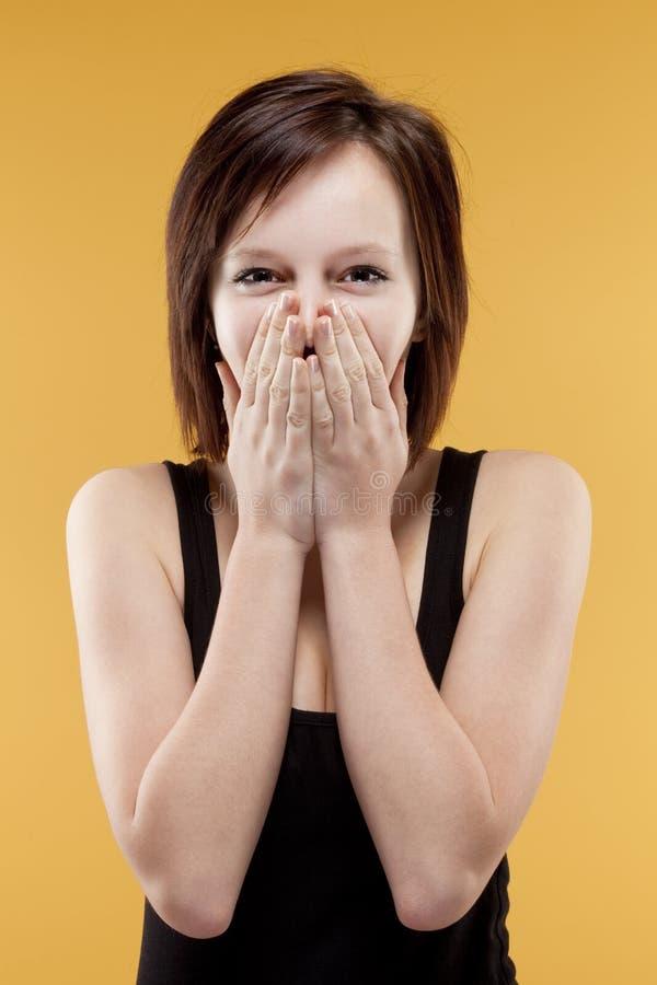 惊奇的十几岁的女孩覆盖物嘴 免版税库存照片