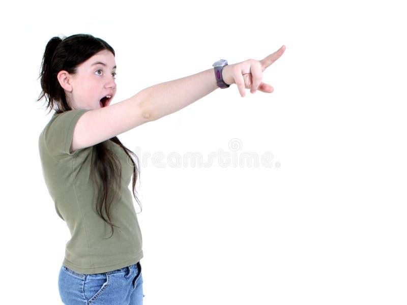 惊奇的女孩指向 免版税库存图片