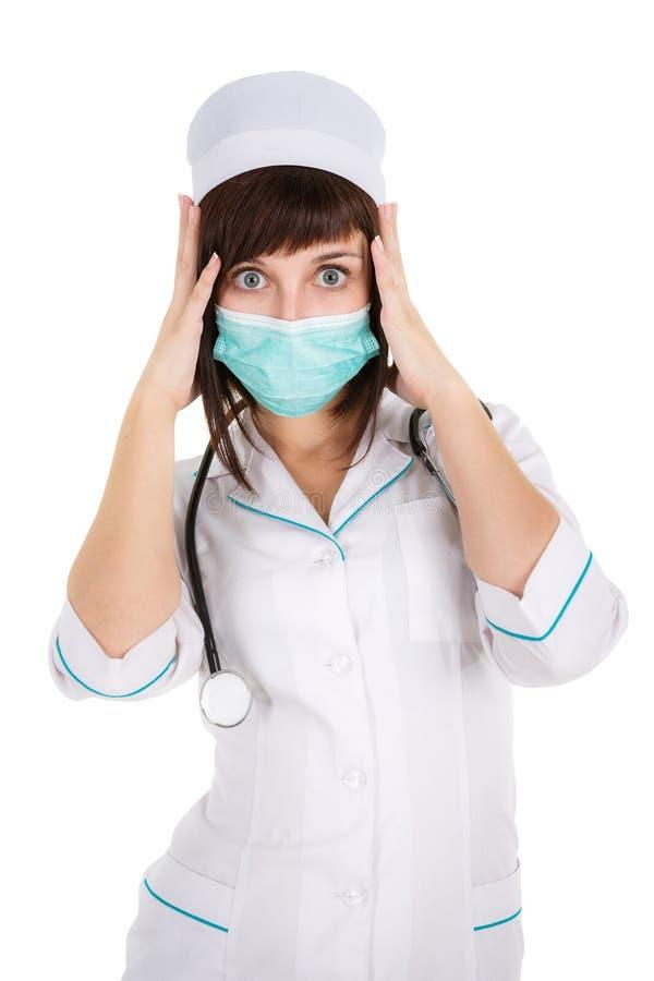 惊奇的妇女医生或护士面具的 图库摄影