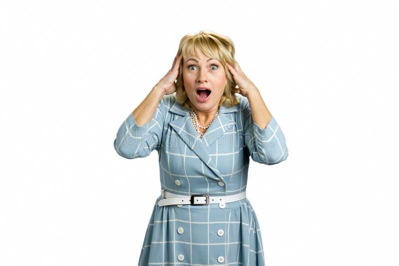 惊奇的成熟妇女开放嘴 免版税库存照片