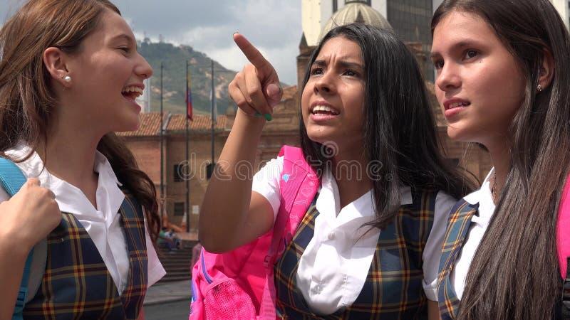 惊奇的或被混淆的女学生指向 免版税图库摄影