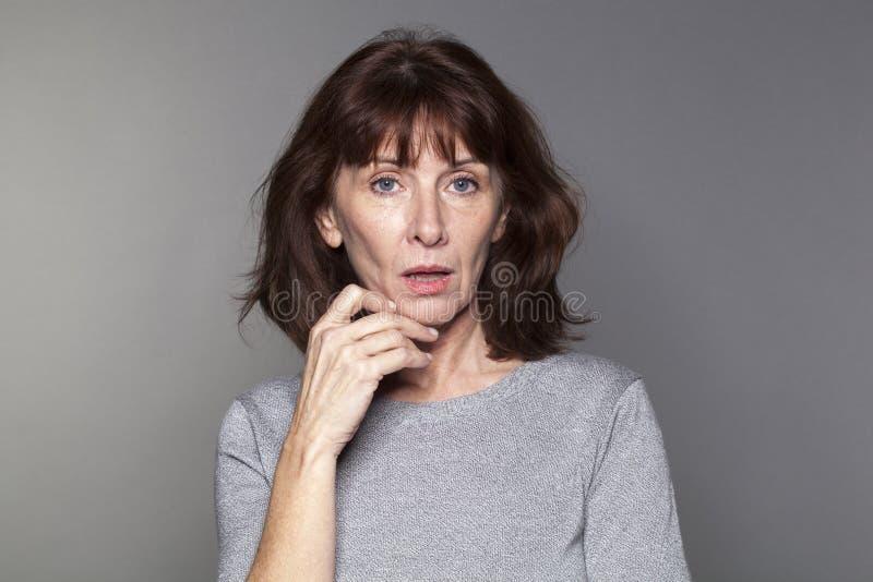 惊奇的美好50s妇女认为 免版税库存图片
