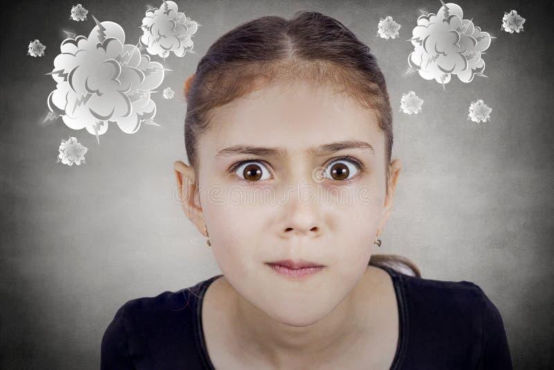 惊奇的,迷茫的滑稽的看起来的小女孩 免版税库存照片