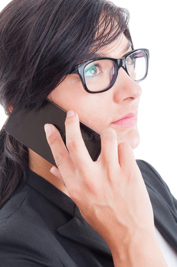 幻想女商人谈话在智能手机 库存图片
