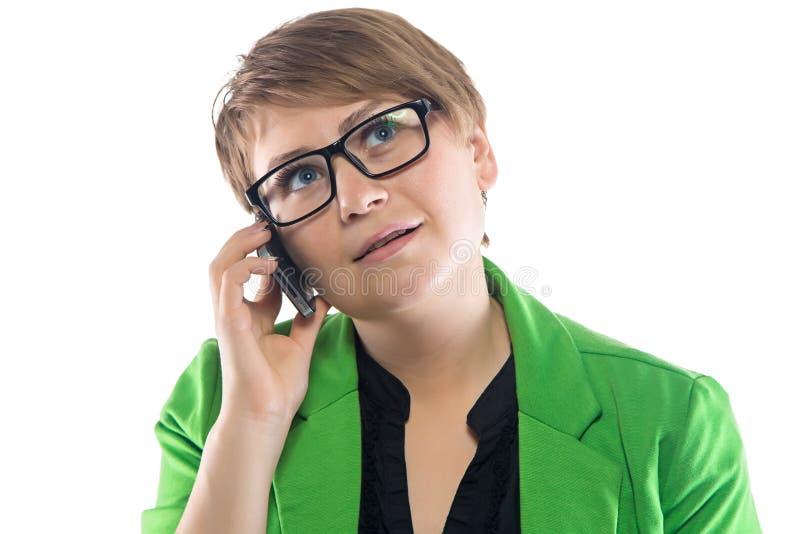想法的妇女照片讲话由电话 免版税库存图片