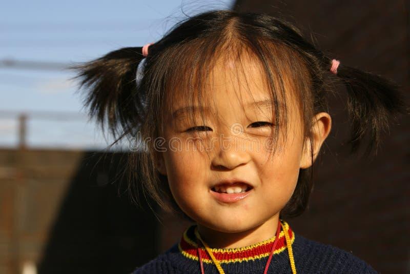 愉快中国的女孩 免版税库存图片