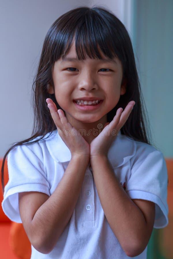 愉快亚裔的女孩一点 免版税库存图片