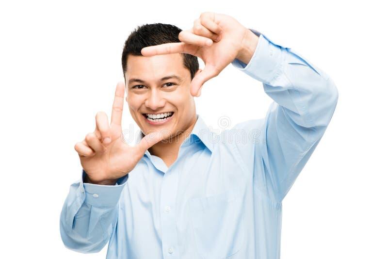 愉快亚洲人手指的框架 免版税库存图片