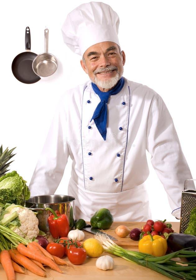 愉快可爱的厨师 免版税库存照片