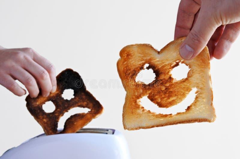 愉快和哀伤的多士面包 免版税图库摄影
