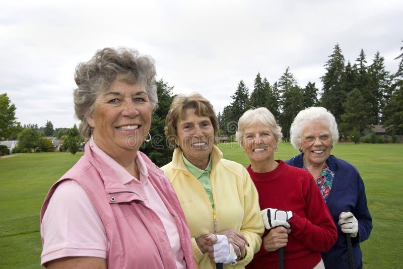 愉快四位的高尔夫球运动员 免版税库存照片