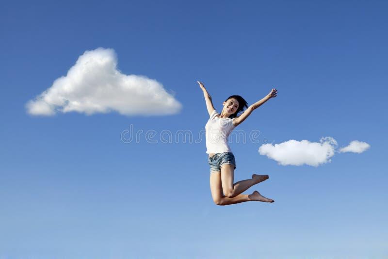愉快地跳妇女的亚洲人 免版税库存照片