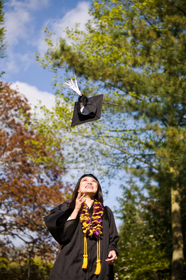 愉快女孩的毕业 免版税库存图片