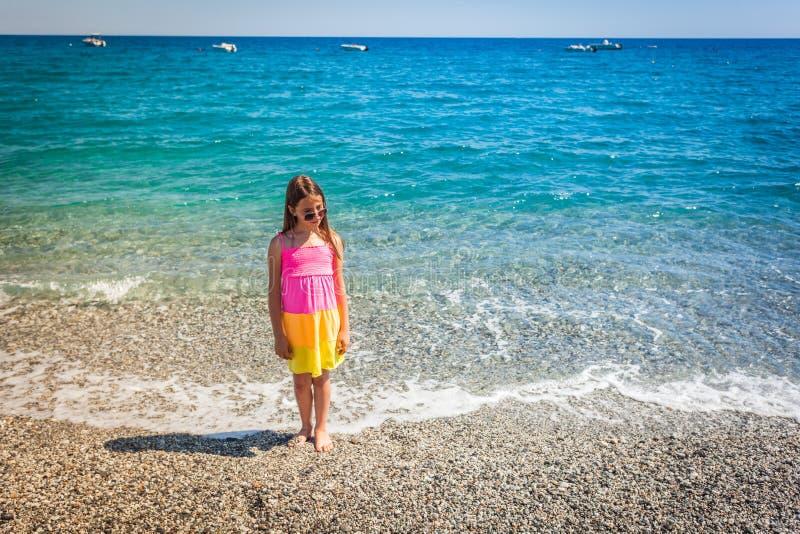 愉快女性孩子享用在暑假时看见 免版税库存照片