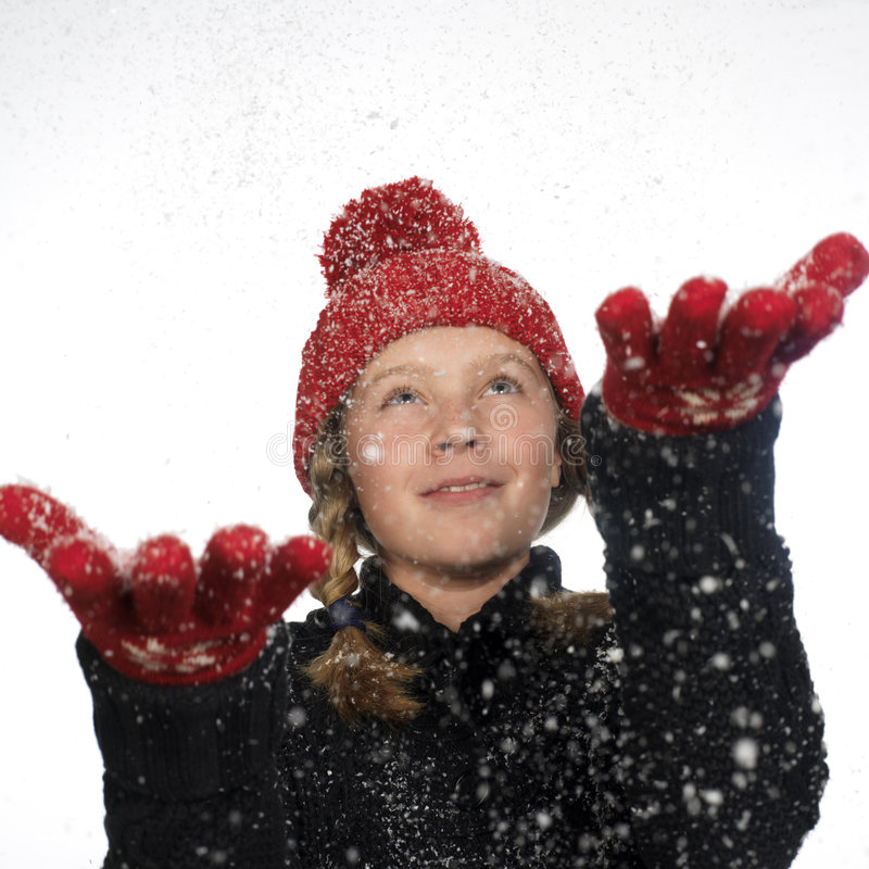 愉快捉住的剥落女孩的现有量她的雪 免版税库存照片