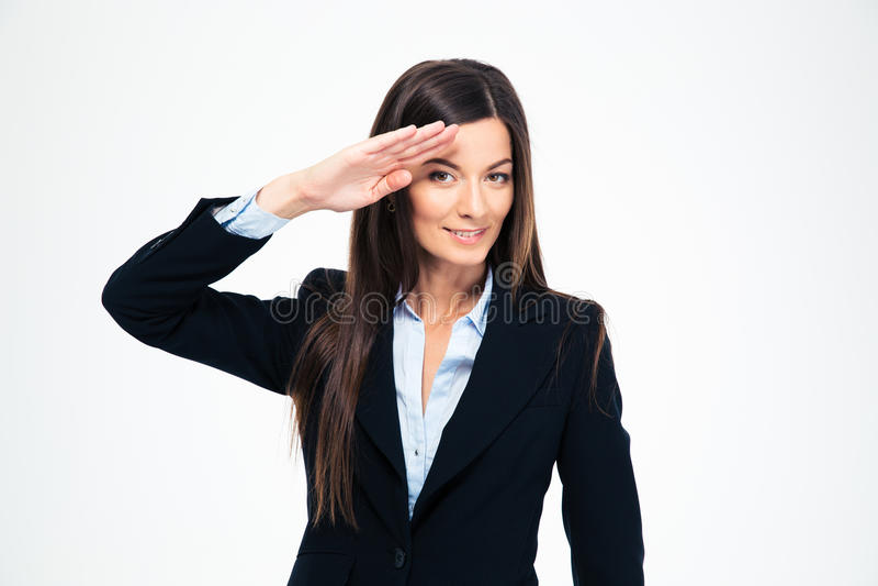 愉快有吸引力女实业家向致敬 免版税库存图片