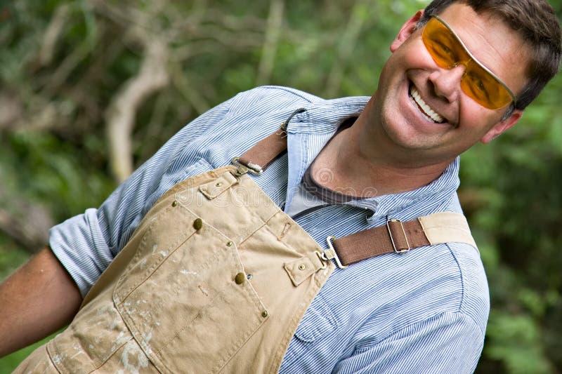 愉快的人微笑的工作者 免版税库存照片