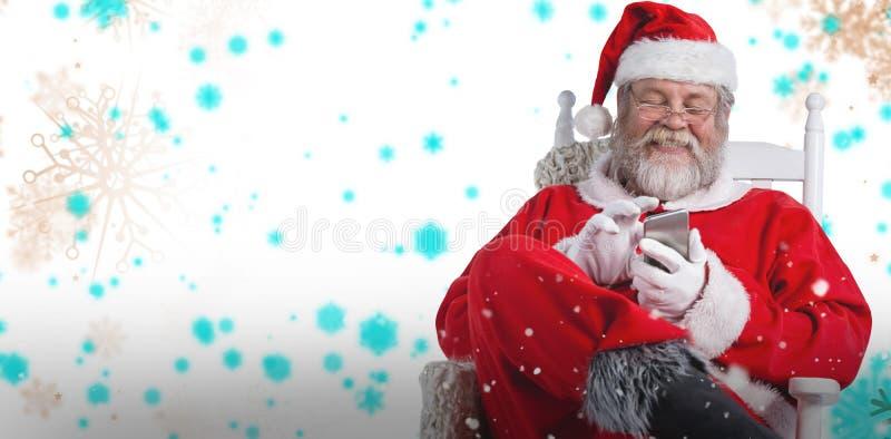 愉快的圣诞老人传讯的综合图象与手机的 库存照片