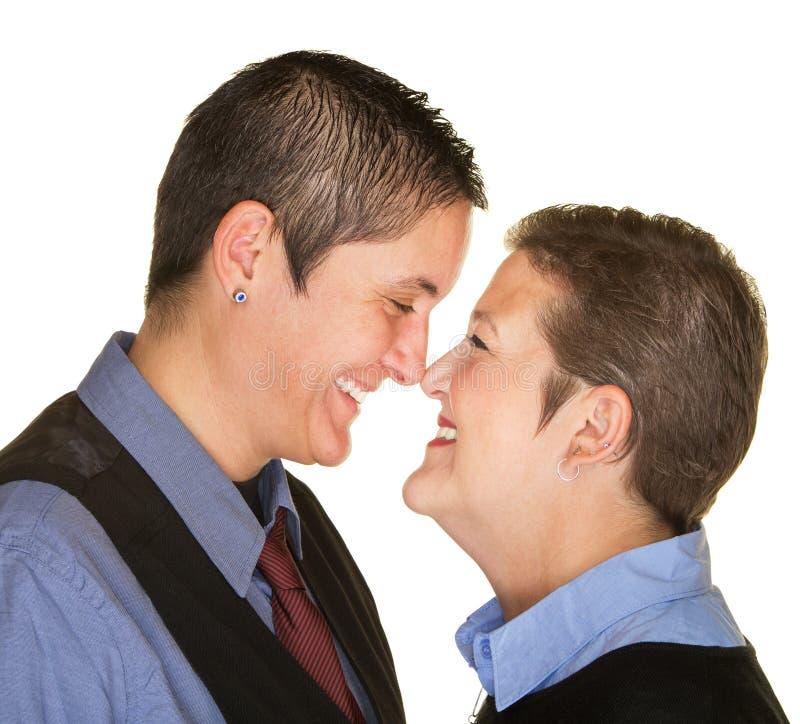 愉快的夫妇感人的鼻子 免版税图库摄影