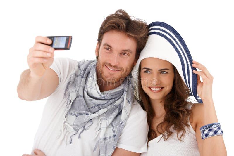 愉快的夫妇拍摄新 免版税库存照片